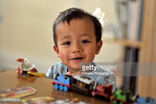 Playing with toy train : Stock Photo