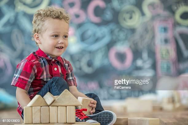 Spielen mit Holz Häuserblocks