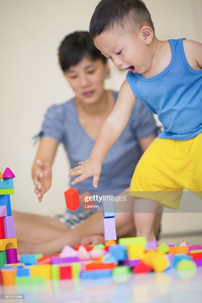 Playing woman and boy : Stock Photo