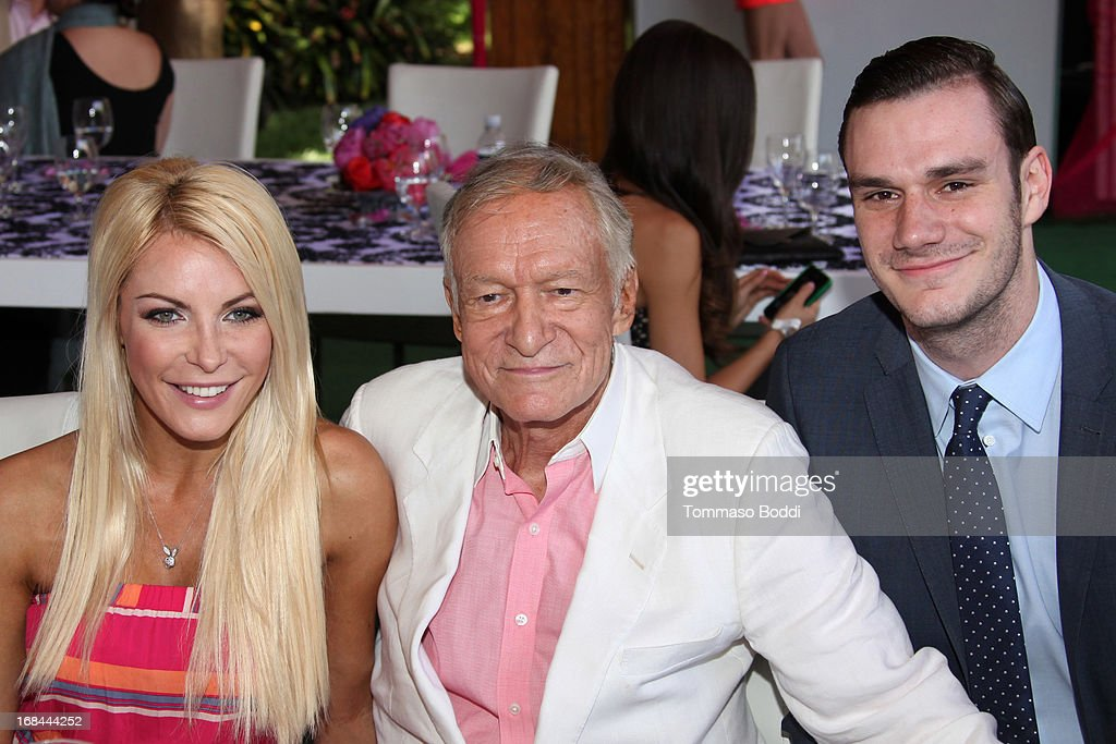 Playmate Crystal Hefner, founder Playboy Enterprises <a gi-track='captionPersonalityLinkClicked' href=/galleries/search?phrase=Hugh+Hefner&family=editorial&specificpeople=202106 ng-click='$event.stopPropagation()'>Hugh Hefner</a> and Cooper Hefner attend the 2013 Playboy Playmate of the Year announcement and reception held at The Playboy Mansion on May 9, 2013 in Beverly Hills, California.