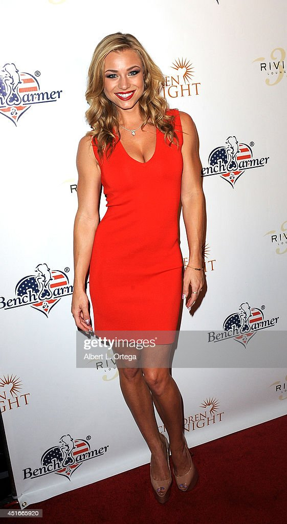 Playmate Nikki Leigh arrives for BenchWarmer's Annual Stars & Stripes Celebration held at Riviera 31 on July 1, 2014 in Beverly Hills, California.
