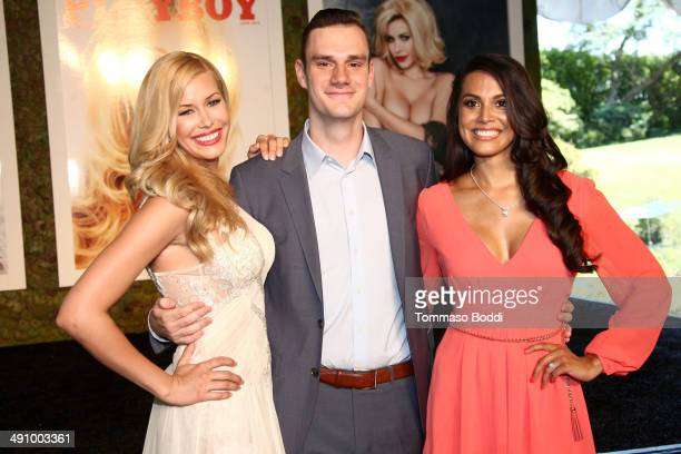 2014 Playmate Of The Year Kennedy Summers Cooper Hefner and 2013 Playmate Of The Year Raquel Pomplun attend the Playboy's 2014 'Playmate Of The Year'...