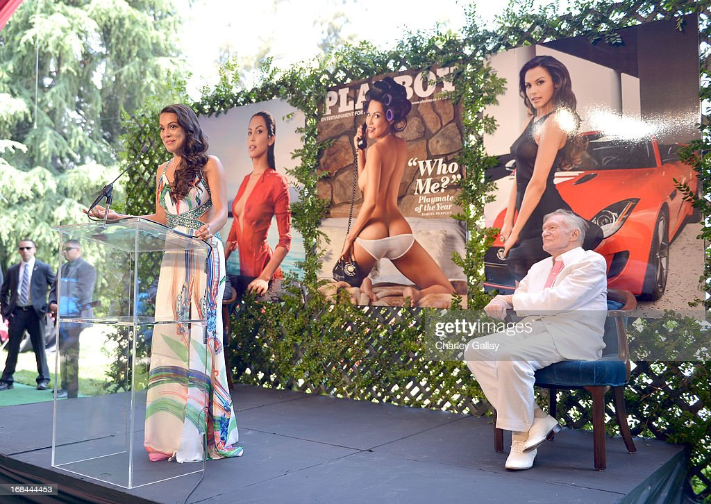 Playmate Of The Year Raquel Pomplun (L) and <a gi-track='captionPersonalityLinkClicked' href=/galleries/search?phrase=Hugh+Hefner&family=editorial&specificpeople=202106 ng-click='$event.stopPropagation()'>Hugh Hefner</a> speak onstage during Playboy's 2013 Playmate Of The Year luncheon at The Playboy Mansion on May 9, 2013 in Holmby Hills, California.