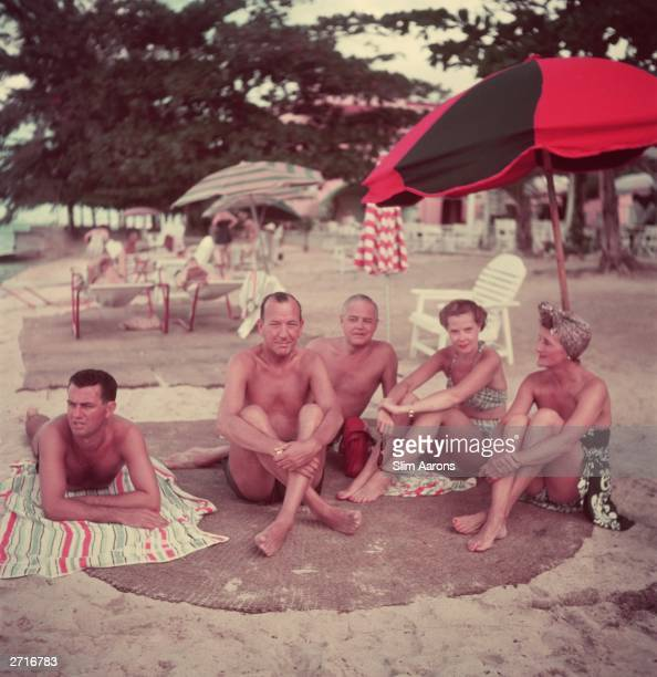 Playwright actor and composer Noel Coward with friends at Sunset Lodge Jamaica From l to r Graham Payn Noel Coward John C Wilson Princess Natasha...