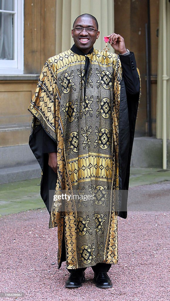 Playwright and actor Kwame Kwei-Armah poses with his Officer of the British Empire (OBE) medal following an Investiture ceremony at Buckingham Palace in central London on December 13, 2012. AFP PHOTO/POOL/SEAN DEMPSEY