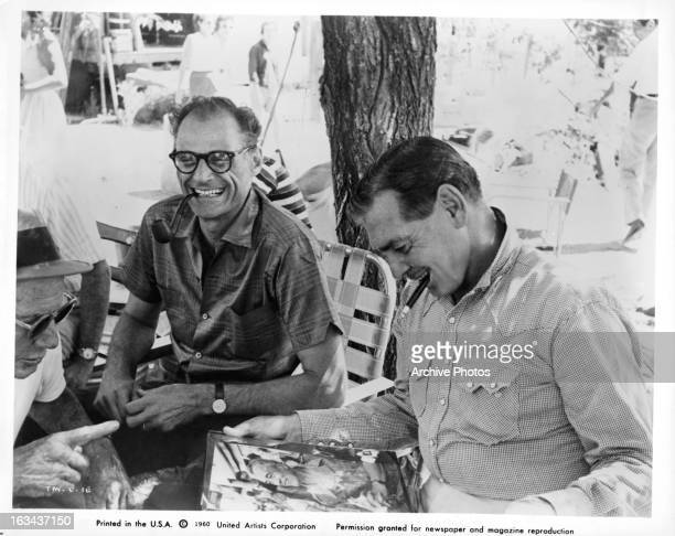Playwright Arthur Miller and Clark Gable sharing a laugh on the set of the film 'The Misfits' 1961