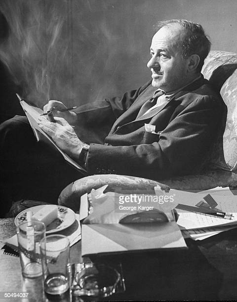 Playwright Ben Hecht pondering his notes