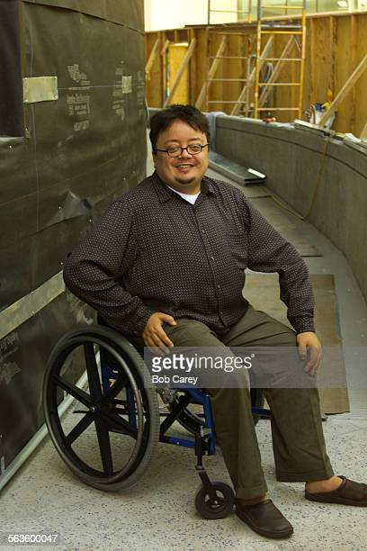 Playwright John Belluso stops his wheelchair on the ramp being built at the Mark Taper Forum to improve access for those with disabilities He wrote...