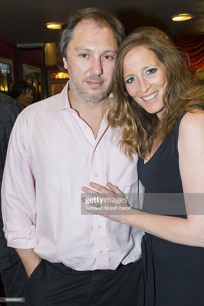 Playwright Sylvain Meyniac (L) and his wife actress Jessica Borio pose following the 100th performance of the play 'Hier Est Un Autre Jour' at Theatre des Bouffes Parisiens on May 11, 2013 in Paris, France.