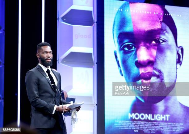 Playwright Tarell Alvin McCraney accepts the Outstanding Film Wide Release Award for 'Moonlight' at the 28th Annual GLAAD Media Awards sponsored by...