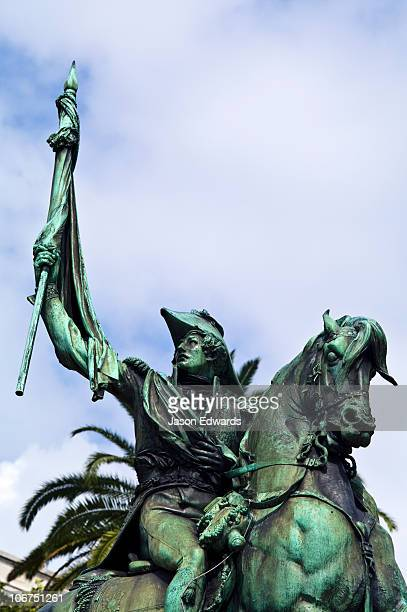 A bronze statue of General Manuel Belgrano carrying an Argentine flag.
