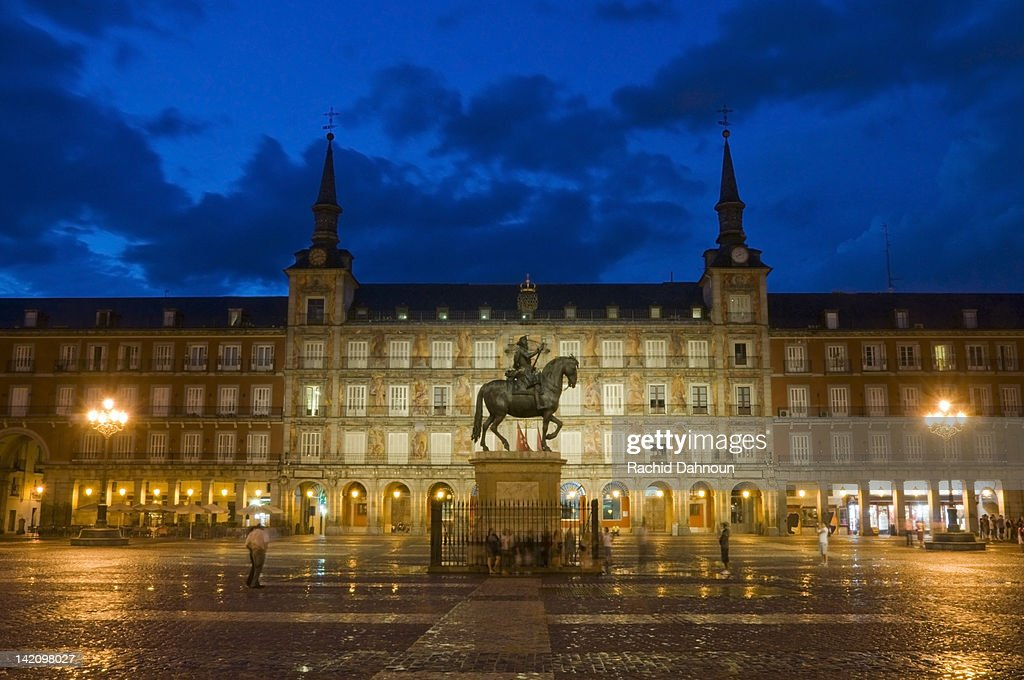 Plaza Mayor at dusk just after a rain storm in Madrid, Spain.