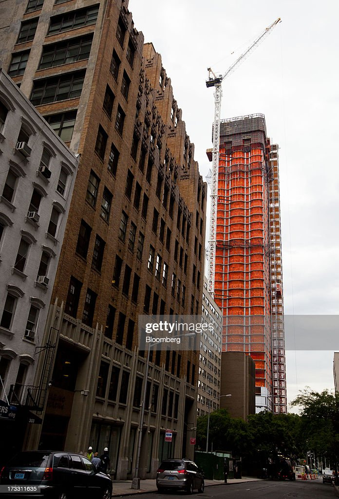 Plaza stands surrounded with orange safety netting in New York, U.S., on Thursday, July 11, 2013. Located across the street from the United Nations, 50 UN Plaza, Arthur and William Lie Zeckendorf's latest Manhattan luxury-condominium project is a 44-story tower that will be the Turtle Bay neighborhood's first new residential project in a dozen years. Photographer: Jin Lee/Bloomberg via Getty Images