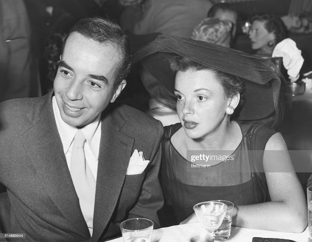A pleasant surprise to their friends in Hollywood was the appearance together of <a gi-track='captionPersonalityLinkClicked' href=/galleries/search?phrase=Judy+Garland&family=editorial&specificpeople=91265 ng-click='$event.stopPropagation()'>Judy Garland</a> and her film director husband, <a gi-track='captionPersonalityLinkClicked' href=/galleries/search?phrase=Vincente+Minnelli&family=editorial&specificpeople=628172 ng-click='$event.stopPropagation()'>Vincente Minnelli</a>. Estranged a short time, the fact that they are once again going places together indicates that there may be a reconciliation announcement before long. The actress and her husband are shown at Ciro's in Hollywood.
