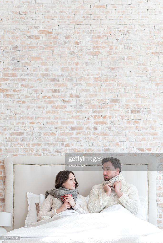 Pleasant young couple looking at each other : Stock Photo