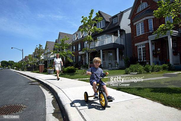 Pleasantville in the Beaches Lynda Chadwick and her son Simon 3 and daughter Sarah 5 play in their yard and walking down their street in the...