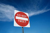 Sign concept about social media addiction saying do not tweet or stop online tweeting