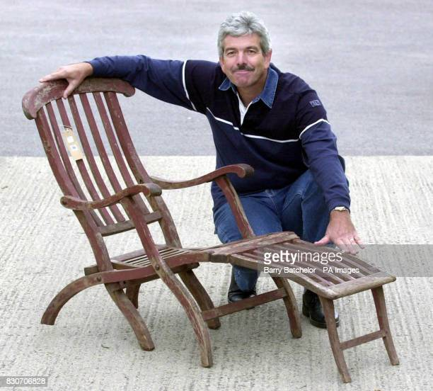Pleased looking memorabilia collector Chris Lowe from Swindon in Wiltshire with a mahogany deck chair with a tiny White Star Line emblem carved into...