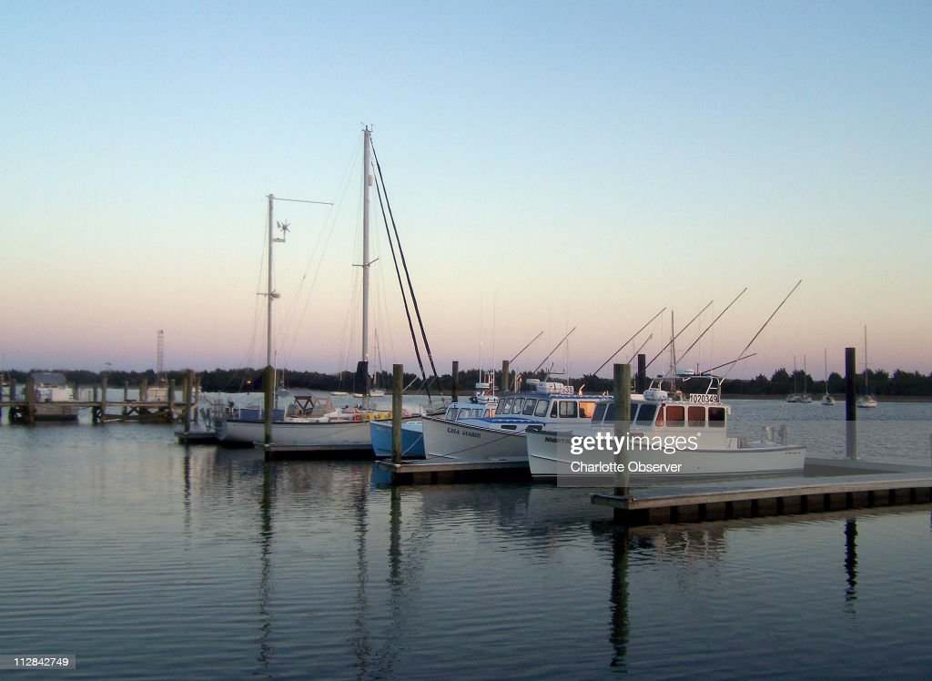 Pleasure boats and fishing boats moor on the waterfront where you can also take narrated nature and history cruises and catch the ferry to...