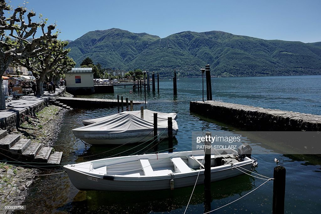 Pleasure boats are moored along the shored of Ascona town on Lago Maggiore also called Lake Langen on May 24, 2016. The German national football team will train here from May 24 until June 3, 2016 for the EURO 2016 taking place in France. / AFP / PATRIK