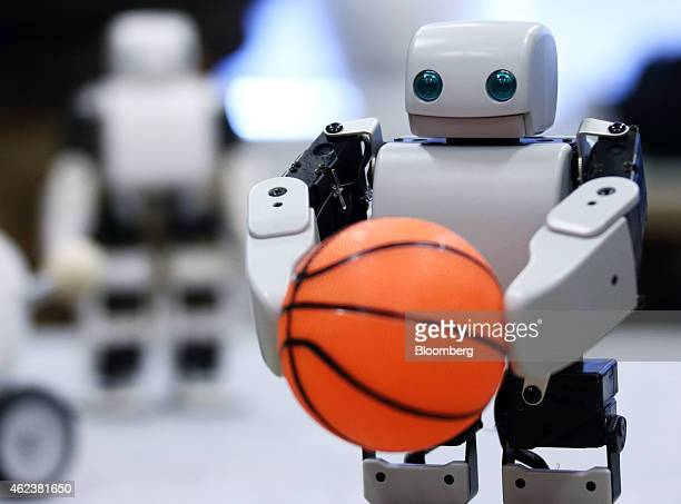A PlenD robot holds a ball during a demonstration at an event hosted by DMM Com Ltd in Tokyo Japan on Tuesday Jan 27 2015 DMM Com a digital contents...