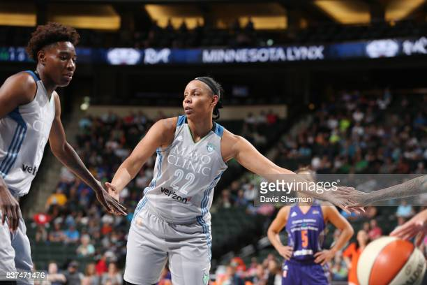 Plenette Pierson and Natasha Howard of the Minnesota Lynx shake hands during the game against the Phoenix Mercury on August 22 2017 at Xcel Energy...