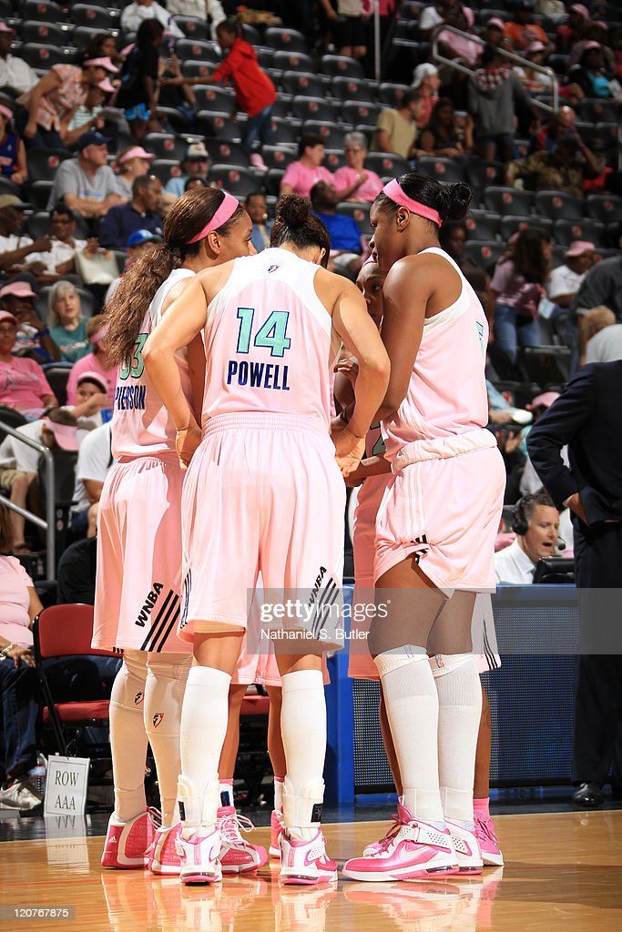 Plenette Pierson Nicole Powell and Kia Vaughn of the New York Liberty during a game against the Seattle Storm on August 9 2011 at the Prudential...