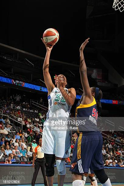 Plenette Pierson of the New York Liberty shoots against Jessica Davenport of the Indiana Fever during a game on August 30 2012 at the Prudential...