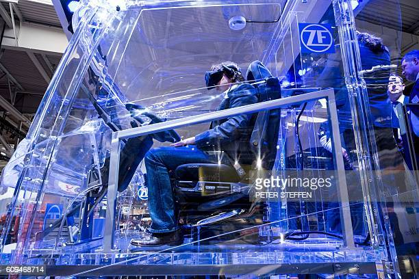 A plexiglas truck is pictured at the booth of ZF Friedrichshafen AG during the IAA Nutzfahrzeuge fair on September 21 2016 in Hanover northern...