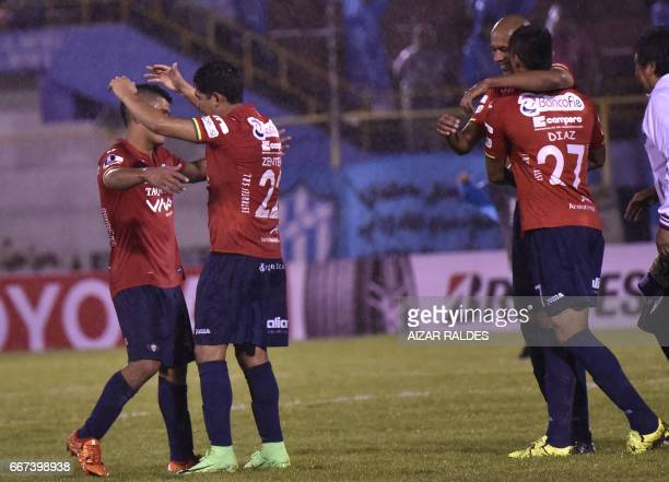 Pleyers of Bolivia's Wilstermann celebrate after scoring against Atletico Tucuman of Argentina during their Copa Libertadores football match at Felix...