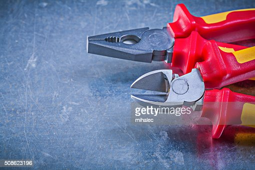 Pliers nippers on metallic background electricity concept : Stock Photo
