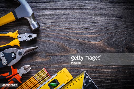 Pliers nippers tin snips claw hammer try square construction lev : Stock Photo