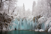 The Plitvice National Park in winter is kingdom of ice. Waterfalls are partially frozen and there are a lot of particular ice formations. The forest is completely white covered by ice.