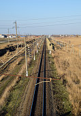Plot railway. Top view on the rails. High-voltage power lines for electric trains.