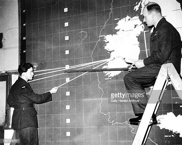 'Plotting the course of rescue planes' 25 Plotting the course of rescue planes' 25 March 1951 An aeroplane is missing over the Atlantic These two men...