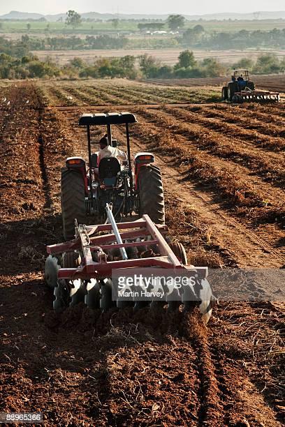 Plough tilling soil.