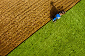 Aerial view of tractor ploughing field