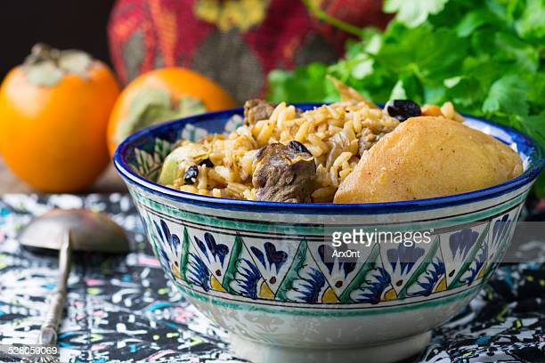 Plov or pilaf with lamb and quince