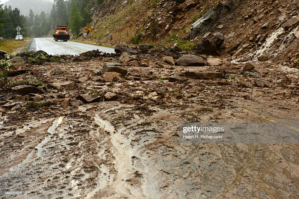 A plow checks out a recent mudslide on Highway 72 near Allenspark, CO on September 12, 2013. Heavy and continuous rains have created devastating and major flooding in many mountain communities as well as huge rock and mudslides off high canyon walls. Some areas have had over 10 inches of rain in the last 24-48 hours.
