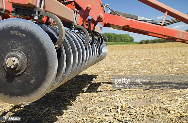 Plow in Harvested Corn Field Ready for Fall Tillage