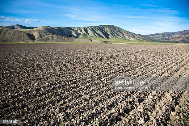 Plowed Field Against Mountains