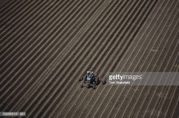 Plowing farm field, aerial view