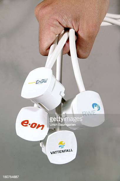 Plugs with the logos of the four major German energy groups eon RWE Vattenfall Europe and Energie BadenWuerttemberg