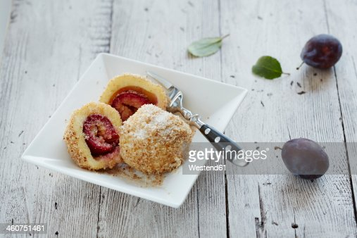 Plum dumpling in bowl on table, close up