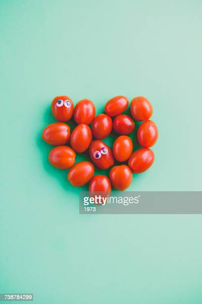 Plum tomatoes with googly eyes in a heart shape