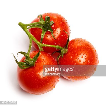 Plum tomatoes with leaves on white background : Stock Photo