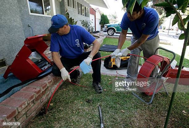 Plumber David L Whyte used a camera to help detect roots in sewer line in Northridge Thursday that can clog pipes quicker than before because hot...