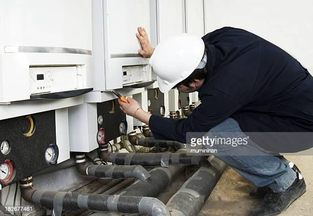 Plumber in the process of a repair