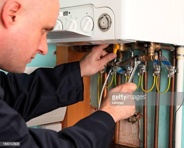 Plumber installing a boiler