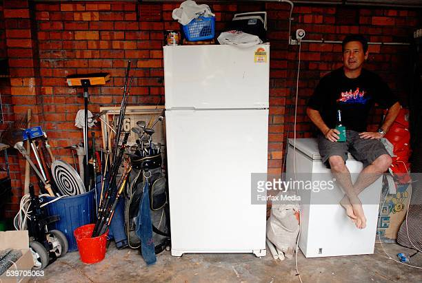 Plumber Stephen Canty of Peakhurst with his old but beloved beer fridge EnergyAustralia is offering $50 and a free removal service for people willing...